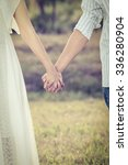 couple holding hands in the... | Shutterstock . vector #336280904
