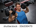 muscular man training his... | Shutterstock . vector #336330470