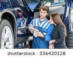 car mechanic with female... | Shutterstock . vector #336420128