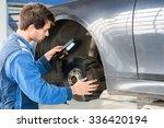 male mechanic holding... | Shutterstock . vector #336420194
