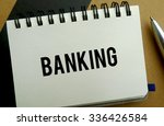Banking memo written on a notebook with pen - stock photo