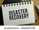 Disaster recovery memo written on a notebook with pen - stock photo
