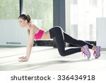 young woman exercising at the... | Shutterstock . vector #336434918