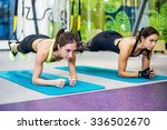 fit girls in gym doing plank... | Shutterstock . vector #336502670