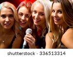 happy girl having fun singing... | Shutterstock . vector #336513314