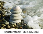 the pyramid of pebbles on the... | Shutterstock . vector #336537803