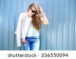 fashion model with long curly... | Shutterstock . vector #336550094