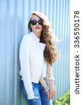 fashion model with long curly... | Shutterstock . vector #336550178