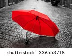 Red Umbrella On Cobblestone...