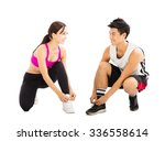happy young couple tying sports ... | Shutterstock . vector #336558614