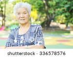 portrait of a smiling elderly... | Shutterstock . vector #336578576