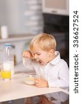 yummy treat. small kid eating a ... | Shutterstock . vector #336627524