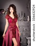 Small photo of Attractive woman in long claret lace dress