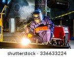 welder working in an industrial ... | Shutterstock . vector #336633224