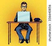 Businessman Works Behind Lapto...