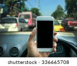 man using a smart phone while... | Shutterstock . vector #336665708