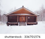 Wooden Log House In Winter...
