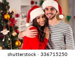 merry christmas. young couple... | Shutterstock . vector #336715250