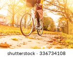 young woman riding a bicycle in ... | Shutterstock . vector #336734108
