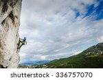 young male climber hanging by a ... | Shutterstock . vector #336757070