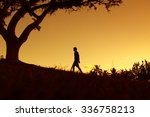 alone man walking in the park.  | Shutterstock . vector #336758213