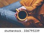 cup of coffee in hands | Shutterstock . vector #336795239