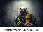 Firefighter In Oxygen Mask...