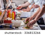 male cooks preparing meals in... | Shutterstock . vector #336813266