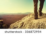 man walking on the edge of a... | Shutterstock . vector #336872954