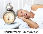 senior man is snoring in bed.... | Shutterstock . vector #336909554