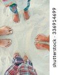 A Family Feet On The Sand On...