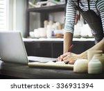 craftsman browsing laptop