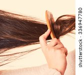 combing with brush and pulls... | Shutterstock . vector #336947780