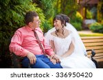 bride and groom sit on the... | Shutterstock . vector #336950420