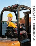 female worker driving cargo... | Shutterstock . vector #33697069