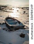 Boat Frozen In Fjord In Winter...