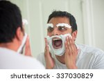 Small photo of Closeup portrait, overzealous mentally deranged, mad as a hatter, young man at the end of his rope, attempting to shave his face eyebrows and face, isolated window reflection