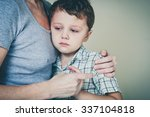 sad son hugging his mother at... | Shutterstock . vector #337104818