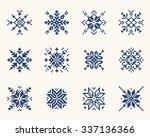 Set ethnic Slavic snowflakes. Red isolated on white background. Norwegian design. Cross stitch scheme.