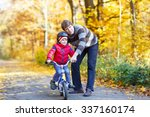 young man and his little son ... | Shutterstock . vector #337160174