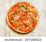 pizza on the wood background   Shutterstock . vector #337188323