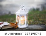Open Book And Lantern On Old...