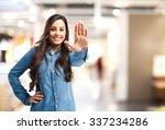 happy young woman stop gesture | Shutterstock . vector #337234286
