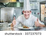 happy chef standing over the... | Shutterstock . vector #337237073