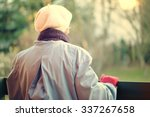 an elderly woman looks off into ... | Shutterstock . vector #337267658