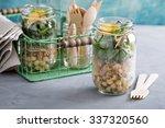 assembling a mason jar salad... | Shutterstock . vector #337320560
