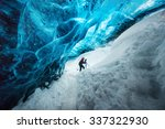Explorer Inside Ice Cave At...