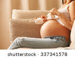 Pregnant Woman Holding Small...