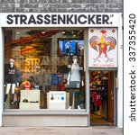 Small photo of COLOGNE, GERMANY - NOVEMBER 2015: Soccer player Lukas Podolski brand Strassenkicker store in Cologne Germany