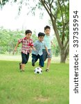 Little Boys Playing Soccer Park - Fine Art prints